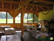 Camping Paradijs - společenská místnost s krbem